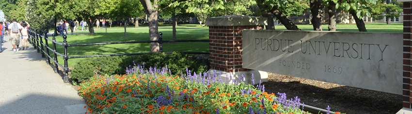 Purdue Sign with Flowers